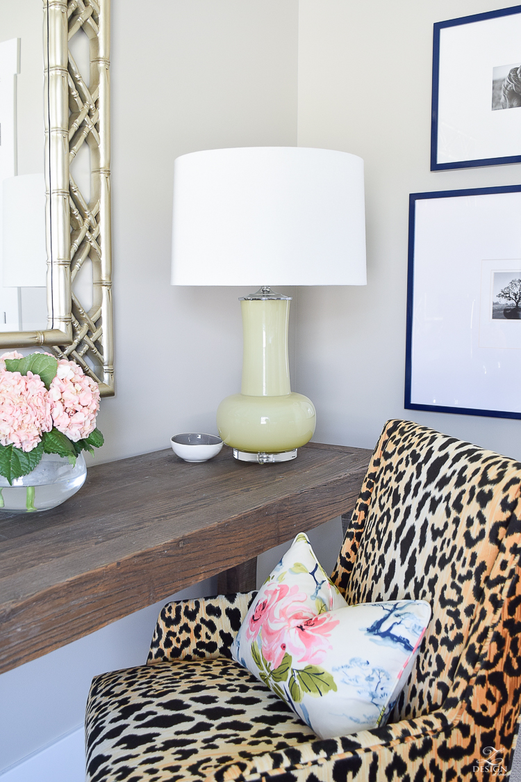 jamie-young-green-glass-lamp-with-acrylic-base-jamil-leopard-chiar-eastern-charm-pillow-fabric-pink-floral-pillow-1