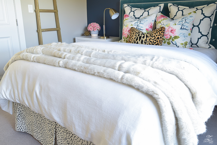 kravet-riad-in-navy-pillows-eastern-charm-floral-fabric-bianca-leopard-fabric-white-faux-fur-throw-navy-accent-wall-2