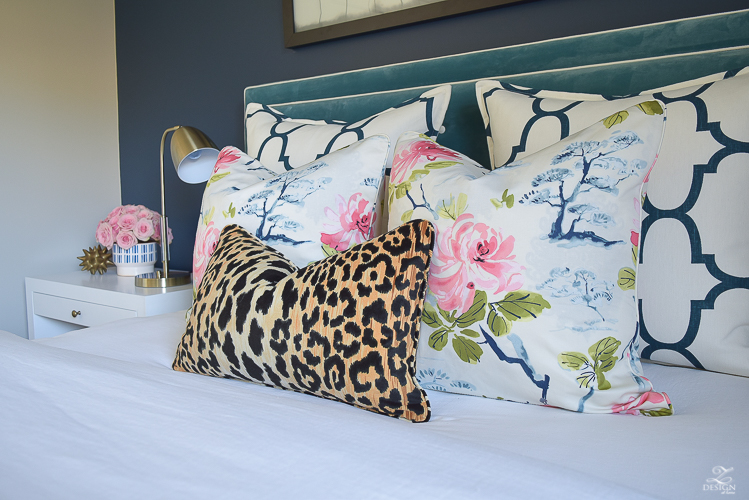 kravet-riad-in-navy-pillows-eastern-charm-floral-fabric-bianca-leopard-fabric-white-faux-fur-throw-navy-accent-wall-4