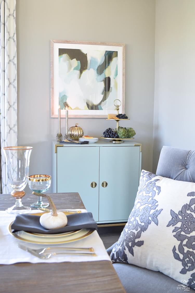 teal-bar-cabinet-minted-abstract-art-golden-bamboo-lamp-vining-velvet-pillow-1