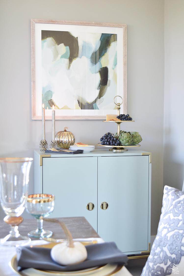 teal-bar-cabinet-minted-abstract-art-golden-bamboo-lamp-vining-velvet-pillow-2