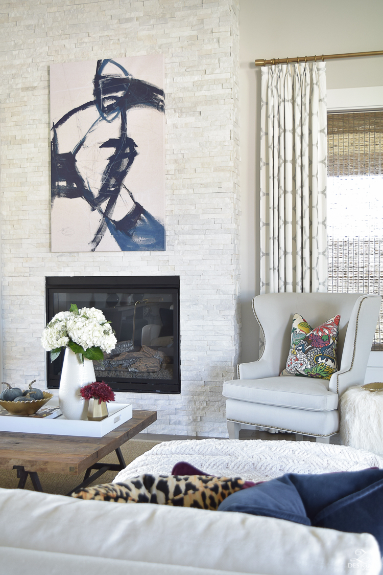 transitoinal-living-room-tour-restoration-hardware-couch-chaing-mia-dragon-fabric-seagrass-rug-navy-abstract-art-white-hydrangeas-fur-stools-4