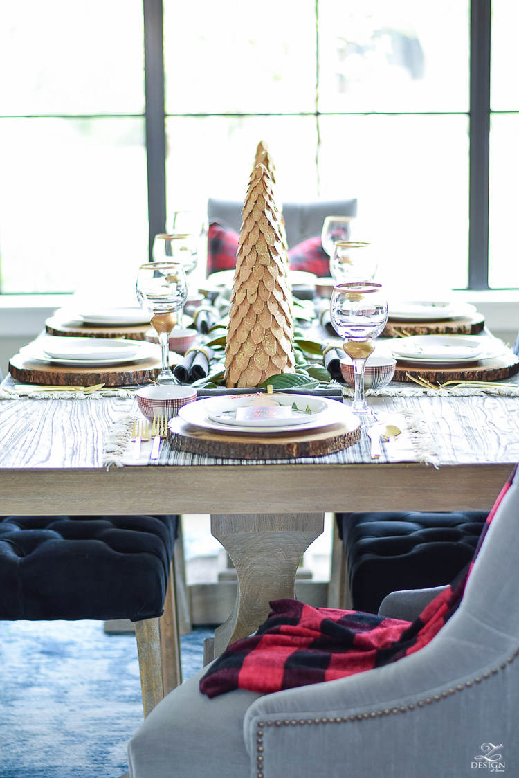 christmas-tour-wood-themed-table-setting-plaid-bowl-magnolia-garland-black-tufted-chairs-2