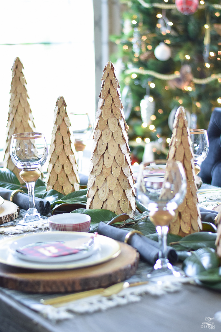 christmas-tour-wood-themed-table-setting-plaid-bowl-magnolia-garland-black-tufted-chairs-5