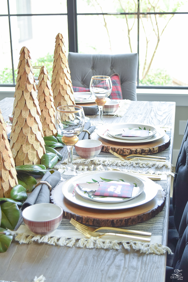 gold-flatware-gold-napkin-rings-fringe-placemats-wooden-placemats-magnolida-garland-christmas-table-setting-4