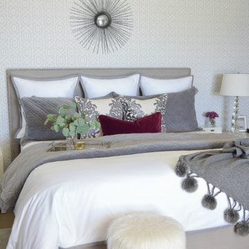 neutral-gray-and-white-bedroom-geometric-wallpaper-gray-nightstands-white-bedding-with-gray-border-gray-velvet-quilt-and-shams-1