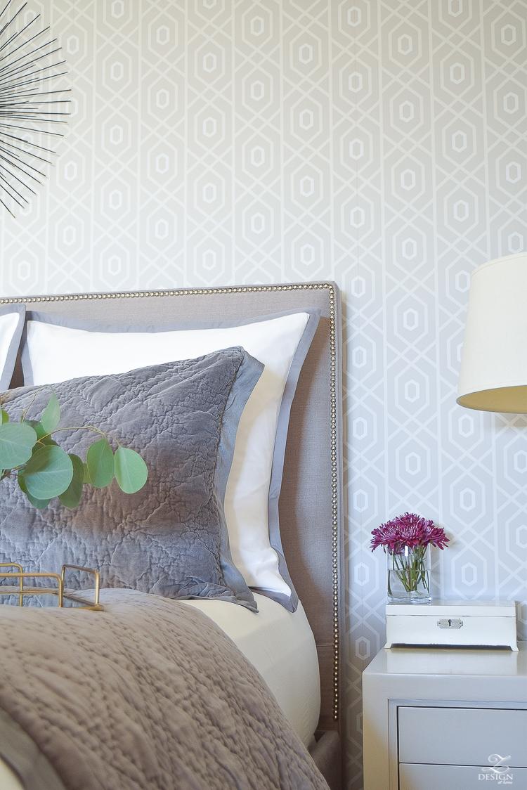 neutral-gray-and-white-bedroom-geometric-wallpaper-gray-nightstands-white-bedding-with-gray-border-gray-velvet-quilt-and-shams-1