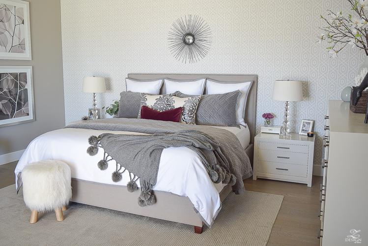 neutral-gray-and-white-bedroom-geometric-wallpaper-gray-nightstands-white-bedding-with-gray-border-gray-velvet-quilt-and-shams-10