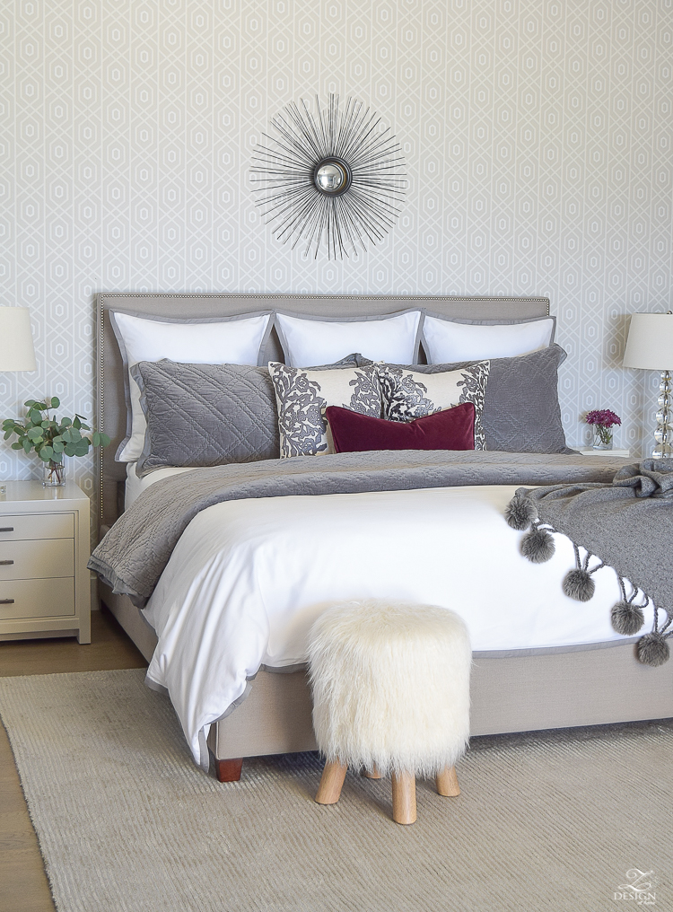 neutral-gray-and-white-bedroom-geometric-wallpaper-gray-nightstands-white-bedding-with-gray-border-gray-velvet-quilt-and-shams-18