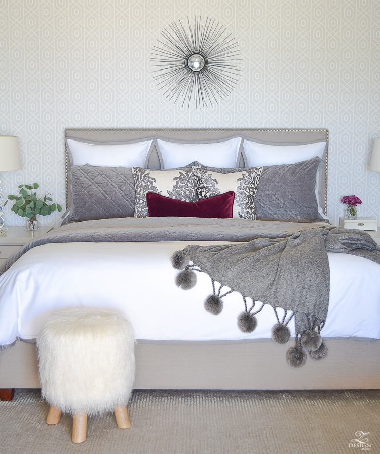 neutral-gray-and-white-bedroom-geometric-wallpaper-gray-nightstands-white-bedding-with-gray-border-gray-velvet-quilt-and-shams-2