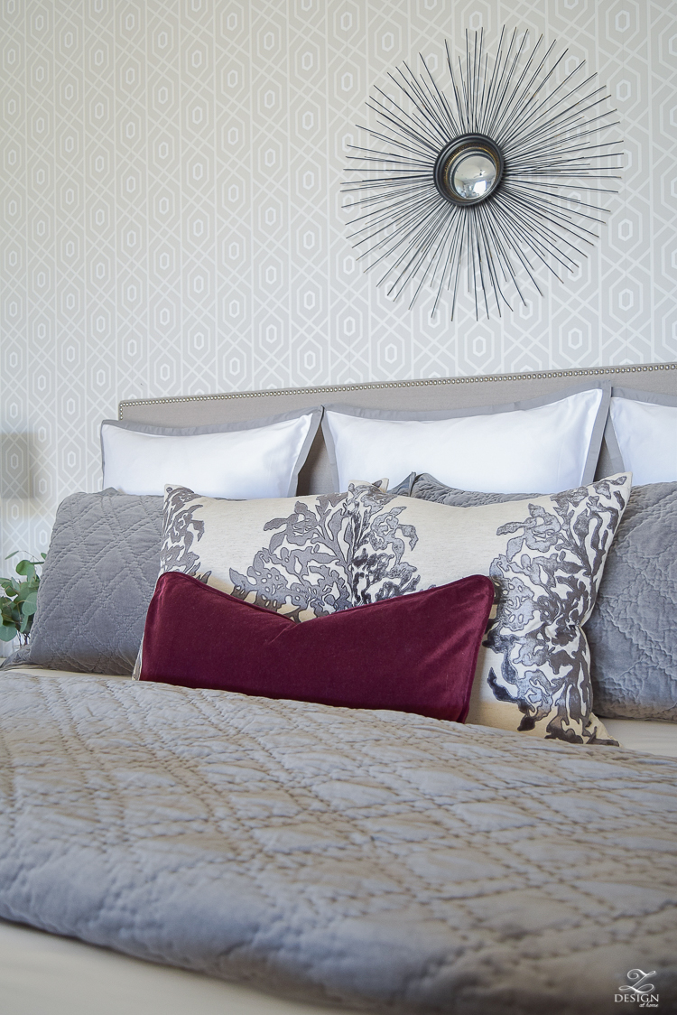 neutral-gray-and-white-bedroom-geometric-wallpaper-gray-nightstands-white-bedding-with-gray-border-gray-velvet-quilt-and-shams-6