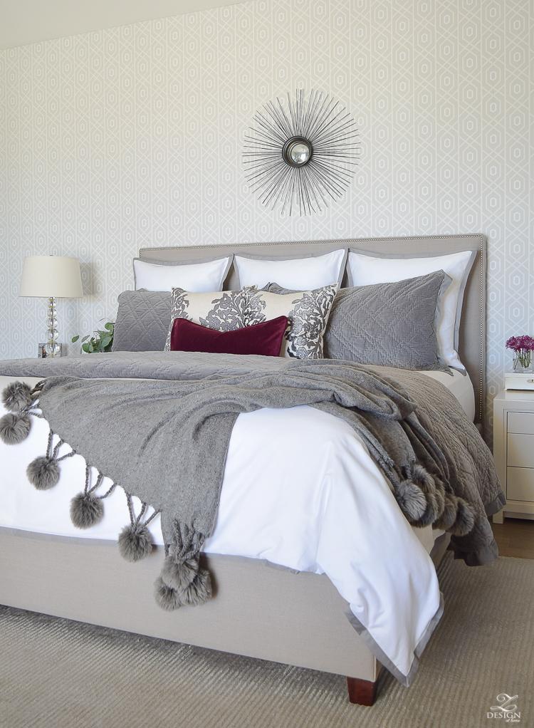 neutral-gray-and-white-bedroom-geometric-wallpaper-gray-nightstands-white-bedding-with-gray-border-gray-velvet-quilt-and-shams-9