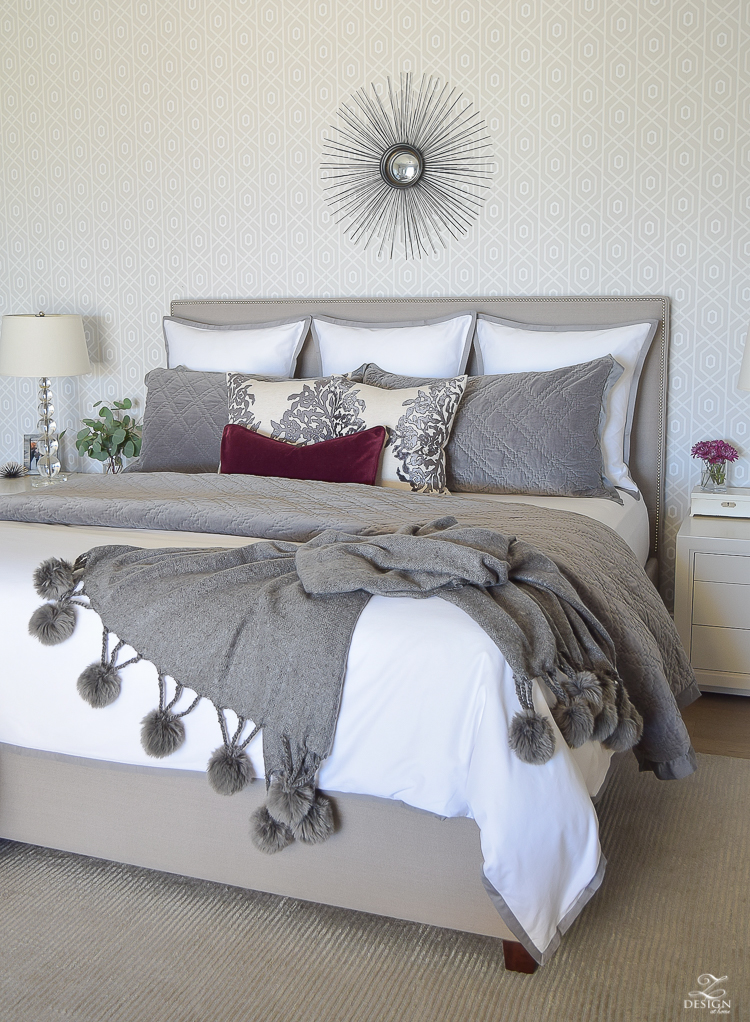 white-bedding-with-gray-border-geometric-wallpaper-pom-pom-throw-neurtral-bedroom-winter-bedroom-white-bedroom-1
