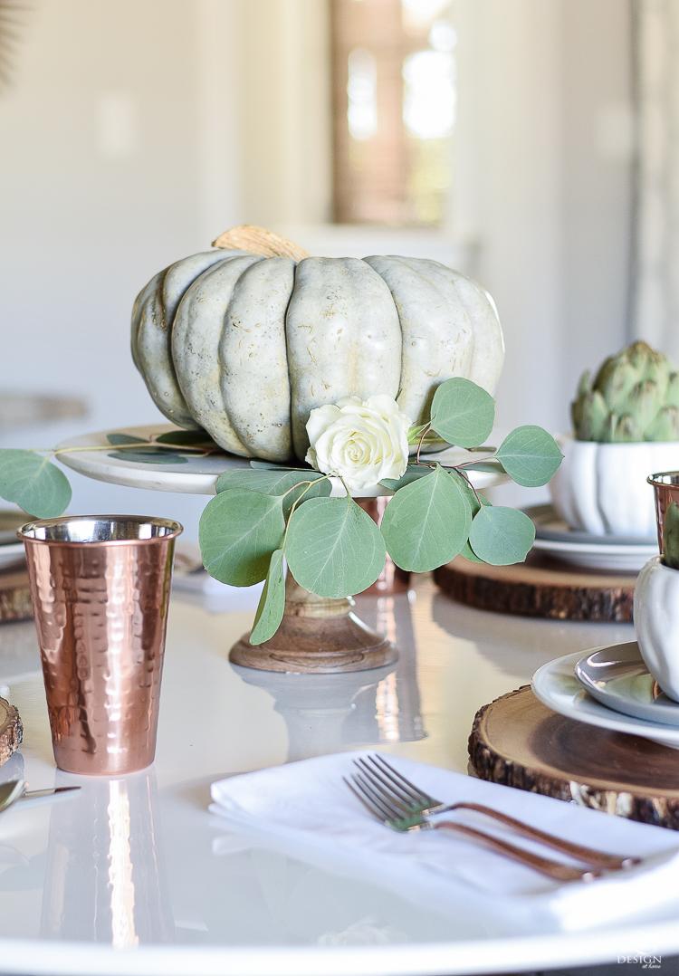 wood-slice-place-mat-white-tulip-table-copper-flatware-copper-tumbler-white-modern-farmhouse-kitchen-thanksgiving-entertaining-table-scape-5