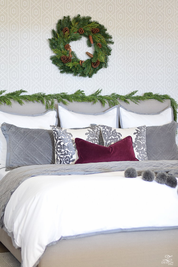 bedroom-christmas-home-tour-chirstmas-bedding-round-faceted-mirror-white-christmas-decor-flocked-tree-geometric-wallpaper-4
