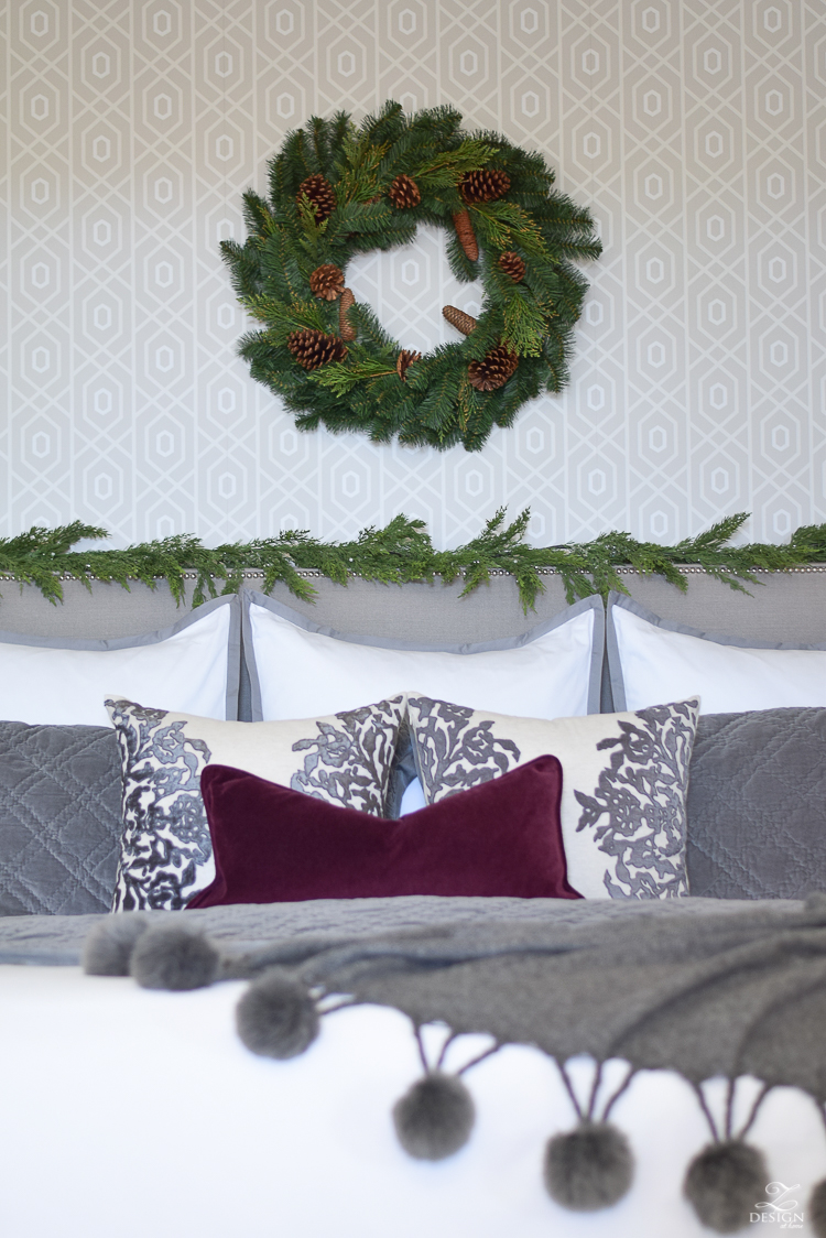 bedroom-christmas-home-tour-chirstmas-bedding-round-faceted-mirror-white-christmas-decor-flocked-tree-geometric-wallpaper-8