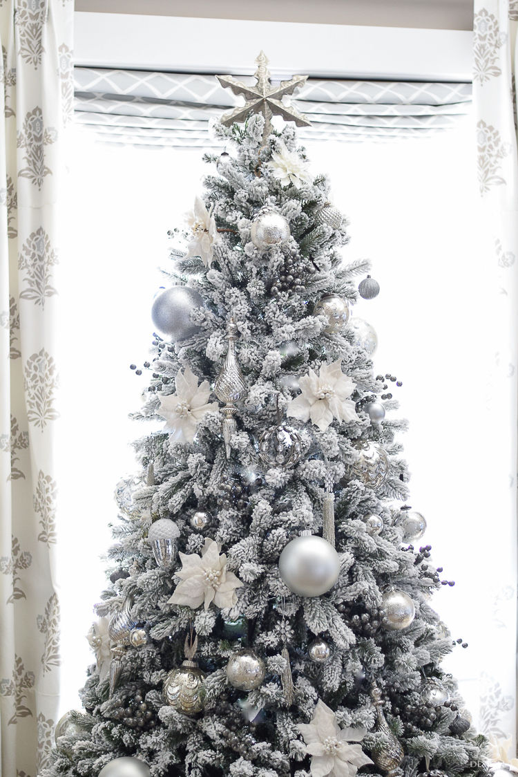 christmas-home-tour-king-of-christmas-flocked-tree-modern-gift-wrap-mercury-glass-ornaments-sheep-skin-rug-tree-skirt-white-and-jeweled-ornaments-6