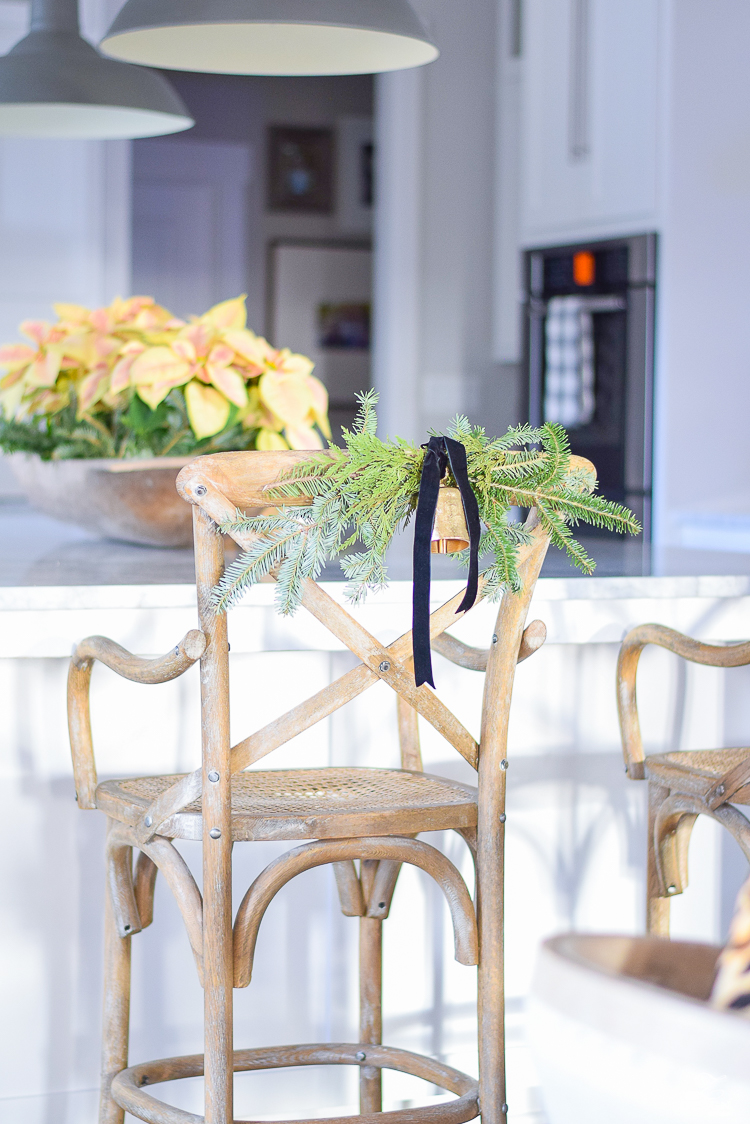 christmas-swag-on-back-of-chair-white-modern-farmhouse-kitchen-with-white-carrar-marble-1