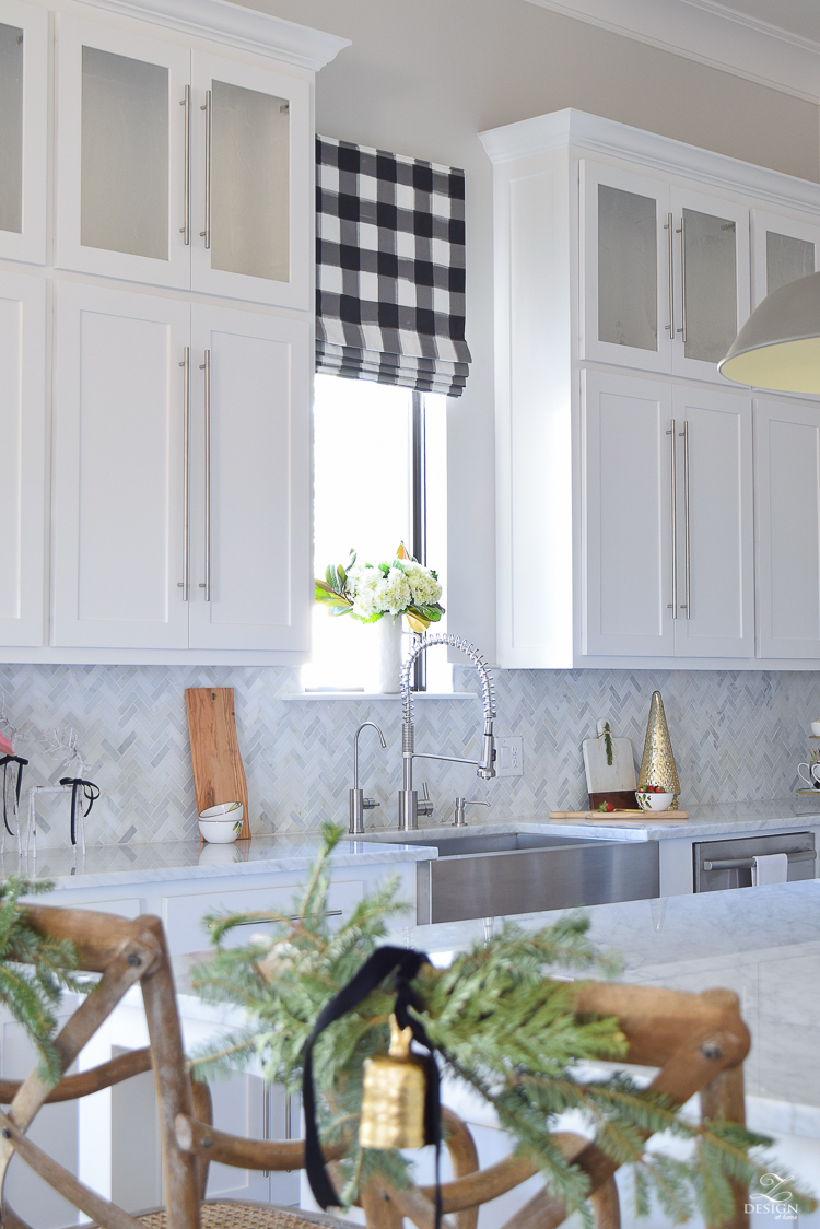 the-drawn-company-faux-roman-shade-with-caitlin-wilson-buffalo-check-fabric-white-farmhouse-kitchen-with-white-carrara-marble-and-herringbone-backsplash-1
