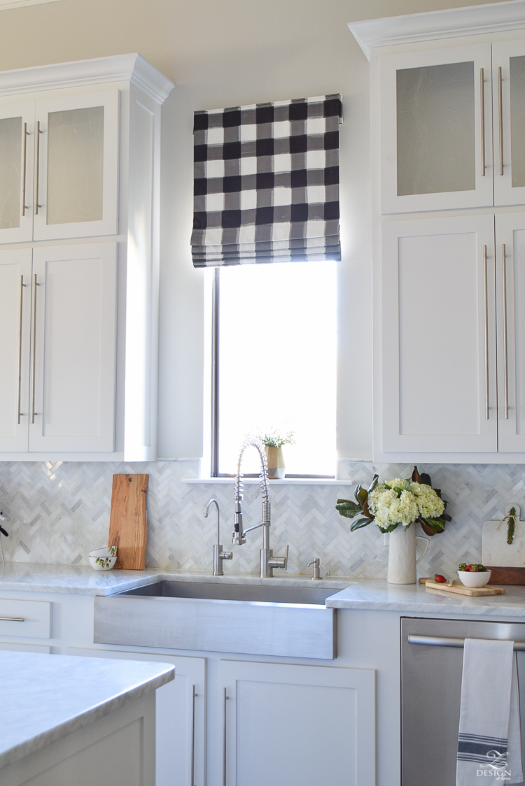 the-drawn-company-faux-roman-shade-with-caitlin-wilson-buffalo-check-fabric-white-farmhouse-kitchen-with-white-carrara-marble-and-herringbone-backsplash-3