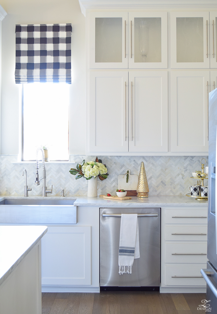 the-drawn-company-faux-roman-shade-with-caitlin-wilson-buffalo-check-fabric-white-farmhouse-kitchen-with-white-carrara-marble-and-herringbone-backsplash-4