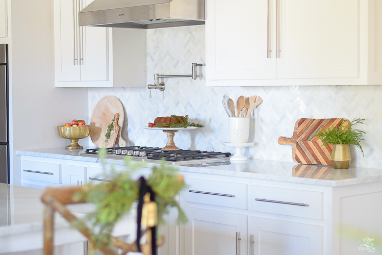 white-modern-farmhouse-kitchen-with-white-carrara-marble-and-white-herringbone-backsplash-christmas-deocr-for-the-kitchen-vintage-barn-pendants-large-dough-bowl-12