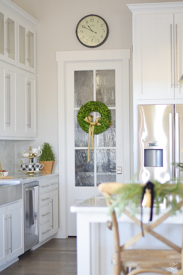 white-modern-farmhouse-kitchen-with-white-carrara-marble-and-white-herringbone-backsplash-christmas-deocr-for-the-kitchen-vintage-barn-pendants-large-dough-bowl-14