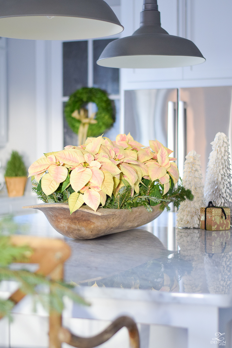 Poinsettias in large bread bowl in white farmhouse kitchen - Christmas Kitchen Tour