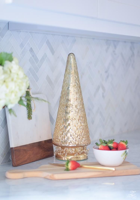 white-modern-farmhouse-kitchen-with-white-carrara-marble-and-white-herringbone-backsplash-christmas-deocr-for-the-kitchen-vintage-barn-pendants-large-dough-bowl-7