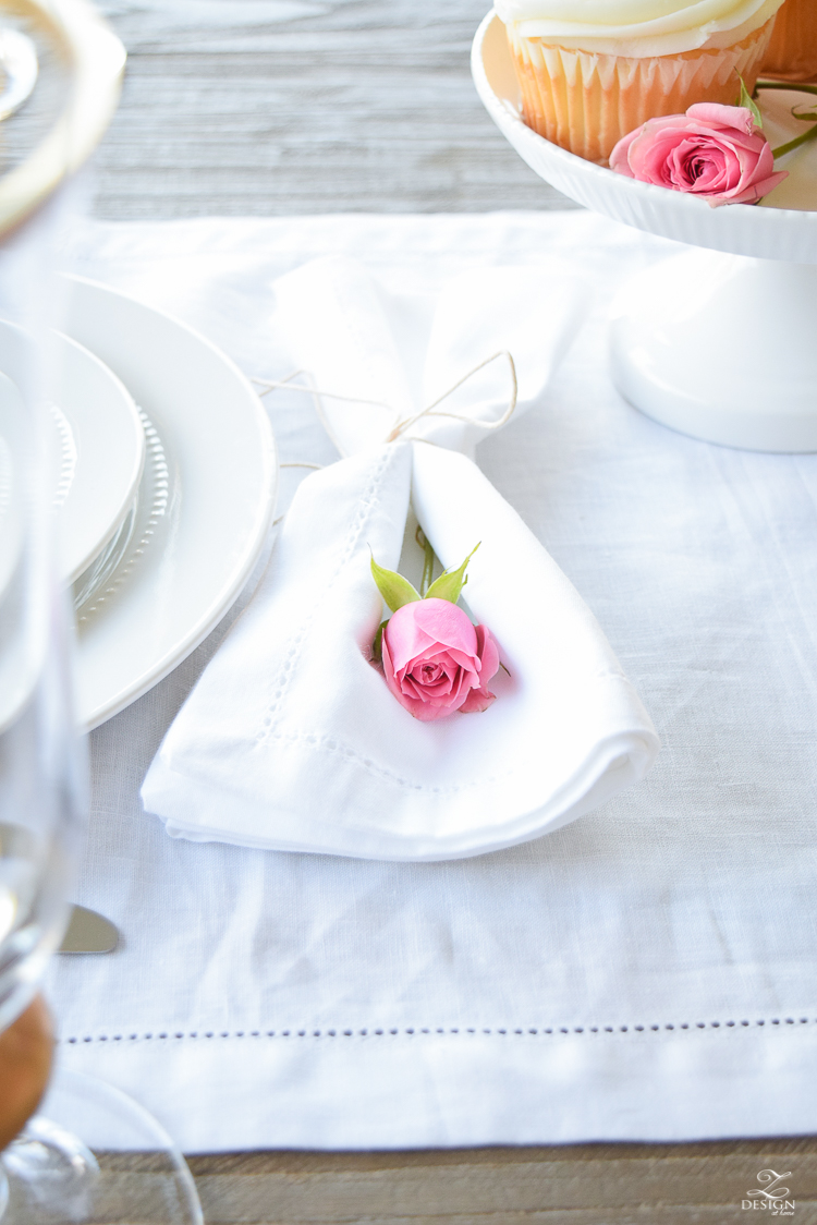 Soft and simple valentines table scape pink rose wrapped in white napkin tied with string white linen table runner-1