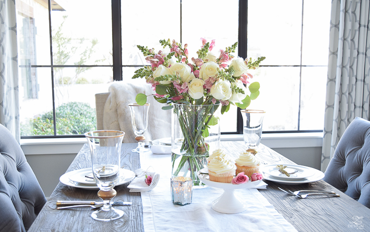Valentines tablescape crystal heart ornament white fur throw flower arrangement with white roses pink snap dragons white cupcakes white dishes-4