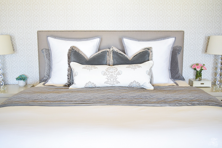 how to make up a beautiful bed pom pom throw gray nailhead upholstered bed white and gray bedroom transitional modern bedroom design-2