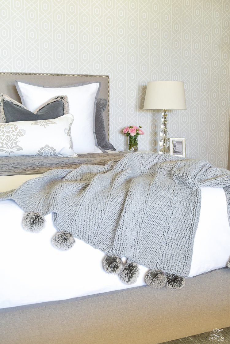 how to make up a beautiful bed pom pom throw gray nailhead upholstered bed white and gray bedroom transitional modern bedroom design-3