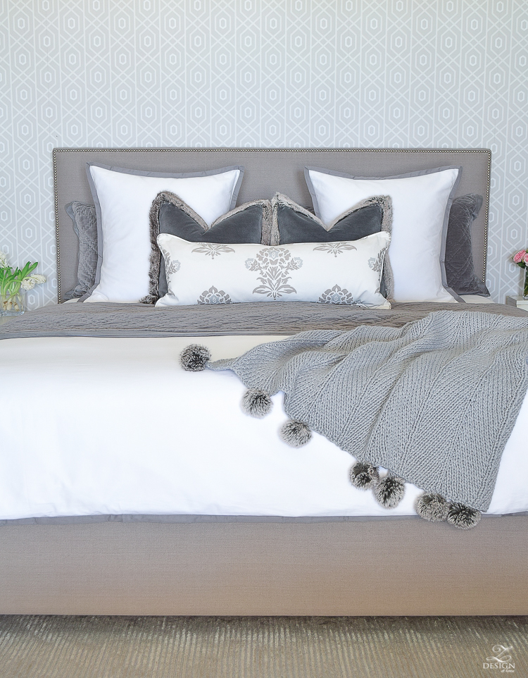 how to make up a beautiful bed pom pom throw gray nailhead upholstered bed white and gray bedroom transitional modern bedroom design-7