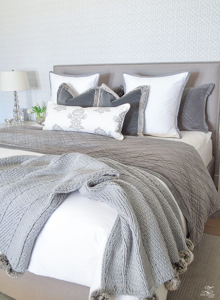 transitional modern gray and white bedroom how to make a bed pom pom throw fur trim pillows velvet bedding gray linen upholstered headbaord thibaut geometric wallpaper-5
