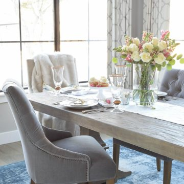 valentines table scape with white and pink roses pink snap dragons gray washed dining table white dishes eternal gold flatware-3