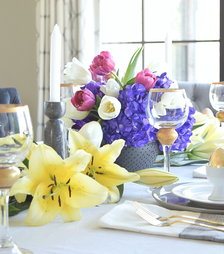 Modern Easter Tablescape yellow lillies purple hydrangeas white beaded dishes gold flatware-CF