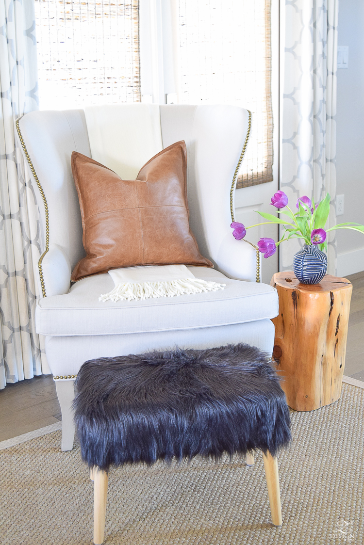 gray wingback chair with brass nail heads kravet riad fabric silver black fur mid century modern stool pottery barn leather pillow west elm stump side table sitting area-3