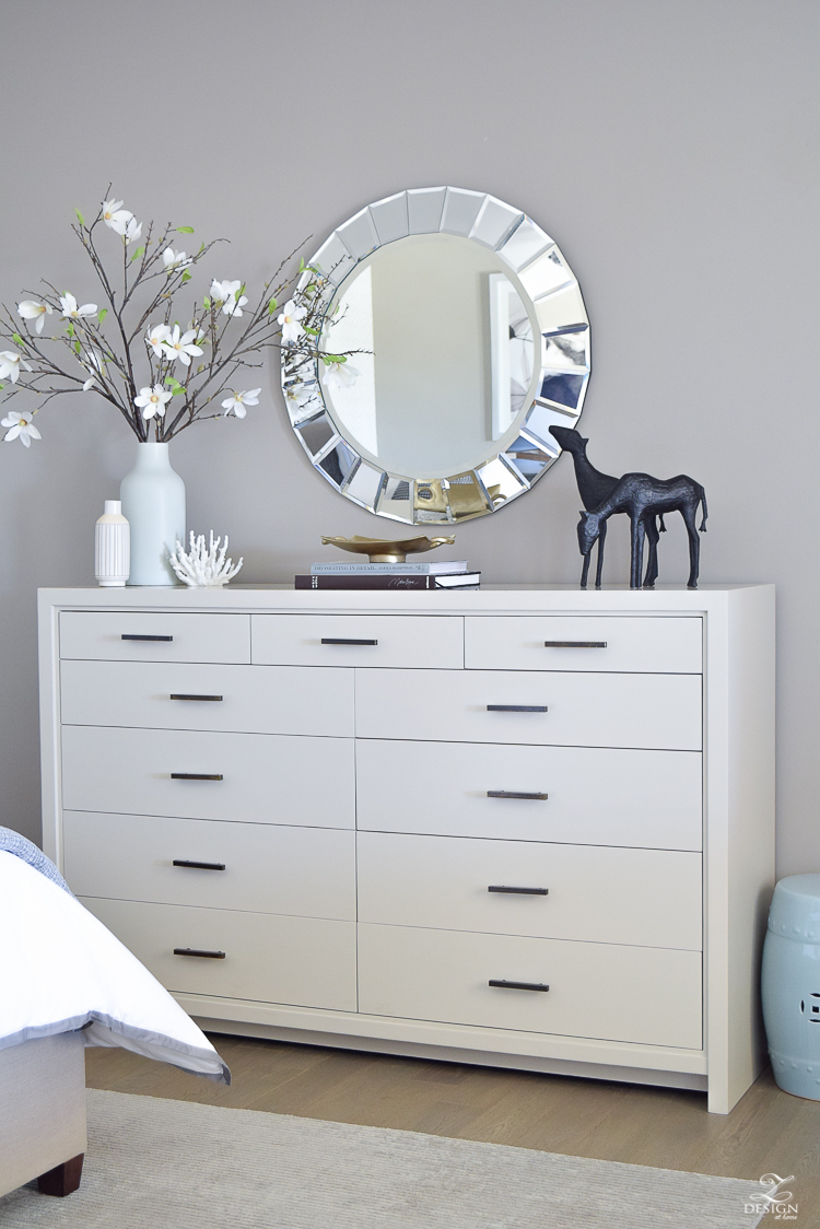 large contemporary dresser round faceted mirror magnolia blossom branches master bedroom spring tour gray dresser with brass pulls-1