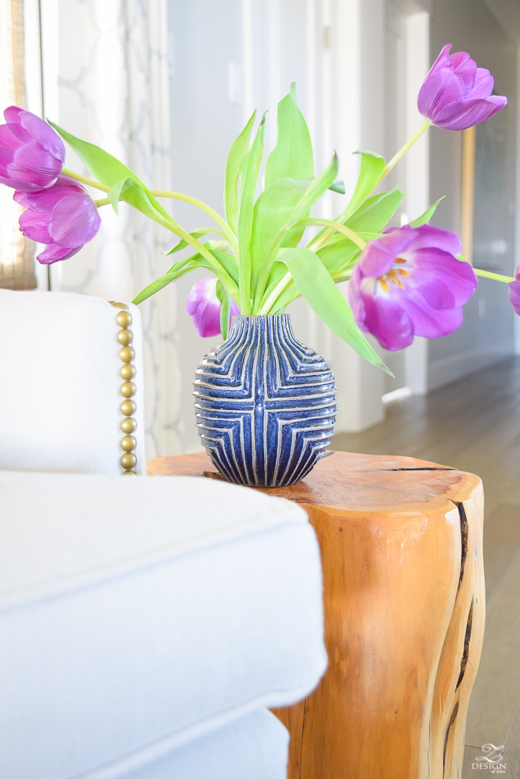 purple tuips blue west elm patterned vase stump side table gray wingback chair-1