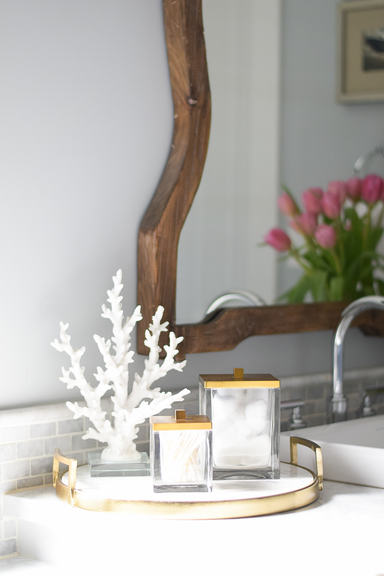 spring bathroom refresh brass and marble accessories coral with acyrlic base wooden mirror white carrara marble image of benjamin more silver lake paint color-3