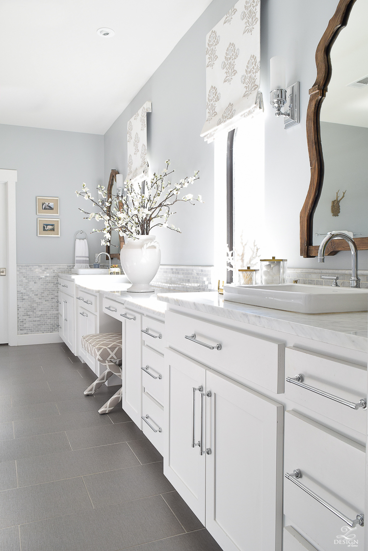 spring bathroom refresh white cabinets faux roman shades brass and marble accessories wooden mirror white carrara marble marble backsplash gray 12 x 24 tile-1