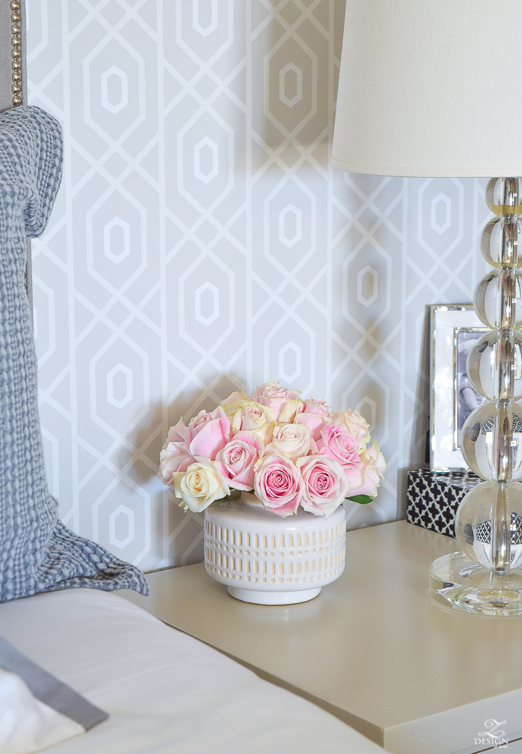 tips for refreshing the bedroom for spring white global vase with pink roses geometric wallpaper black home decor accessories honey comb duvet and shams -1