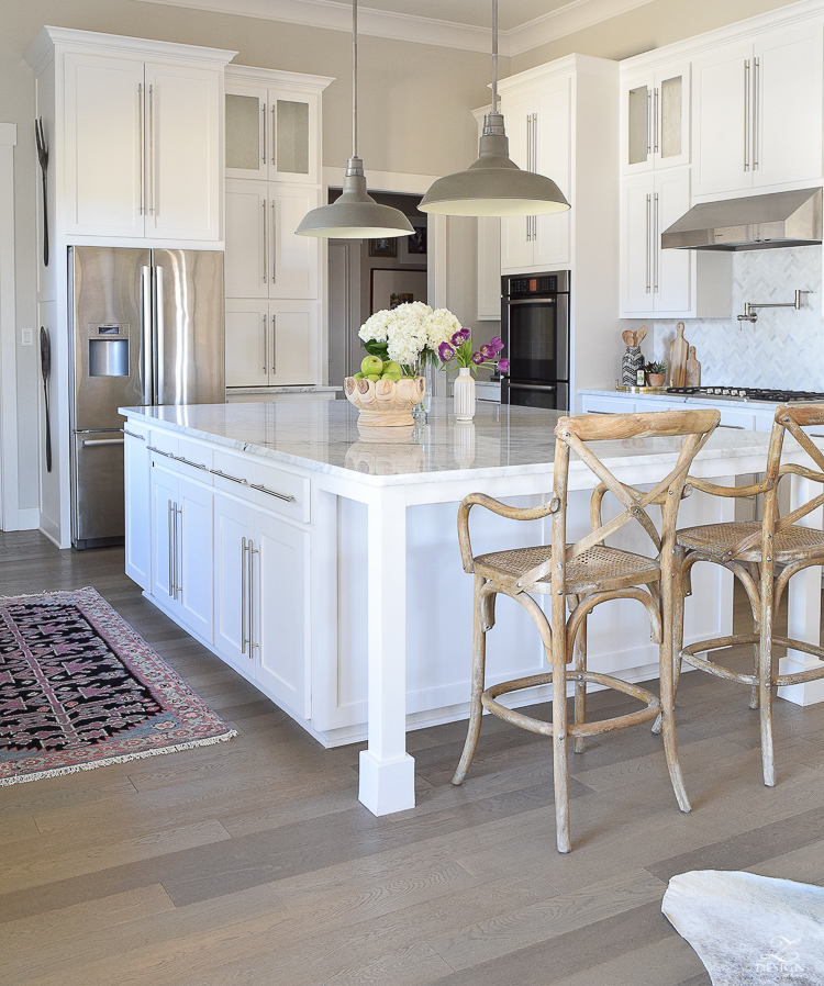 white farmhouse kitchen zdesign at home spring tour vintage barn pendants caitlin wilson rugs gray wood floors white cabinets SW on the rocks paint-1