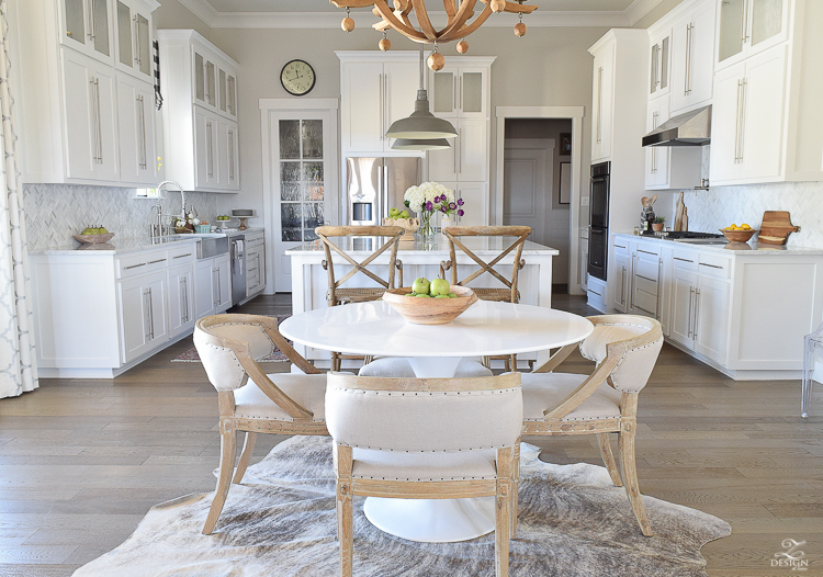white farmhouse kitchen zdesign at home spring tour vintage barn pendants caitlin wilson rugs gray wood floors white cabinets SW on the rocks paint-2