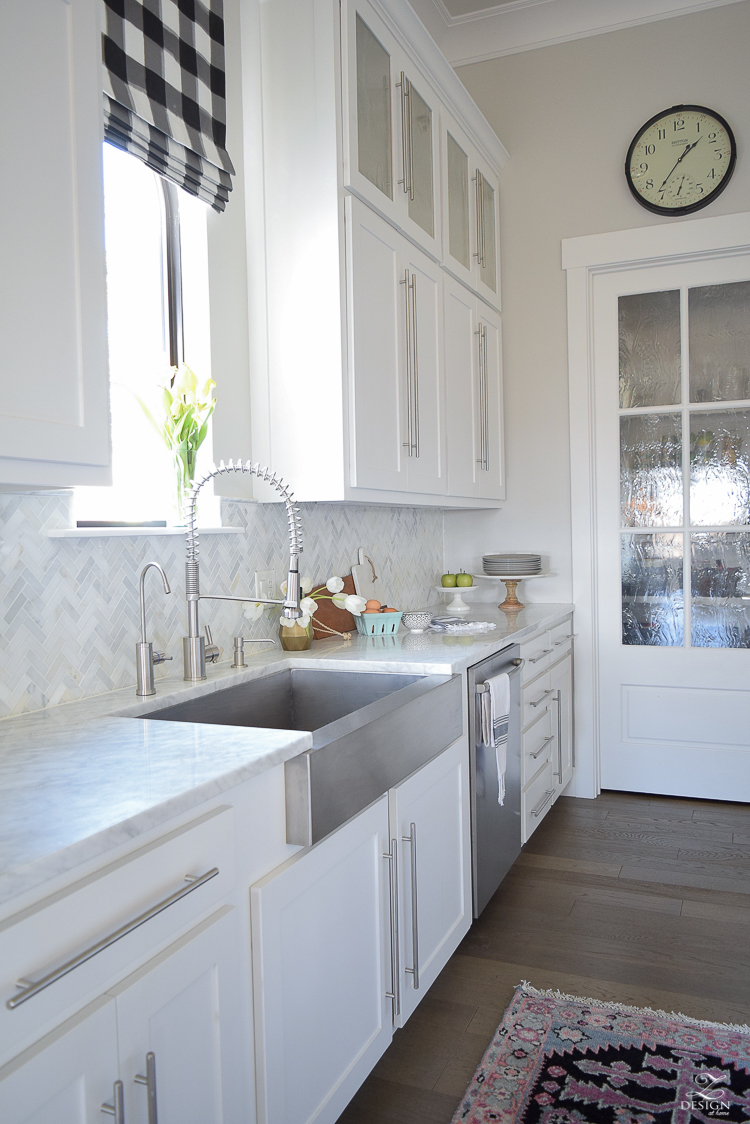 white farmhouse kitchen zdesign at home spring tour vintage barn pendants caitlin wilson rugs gray wood floors white cabinets SW on the rocks paint-5