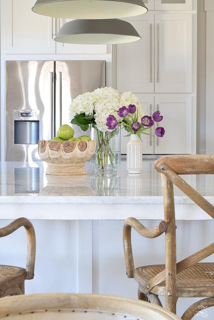 zdesign at home spring home tour modern white farmhouse kitchen carrara marble counter tops white shaker cabinets vintage barn pendants white hydrangeas-4