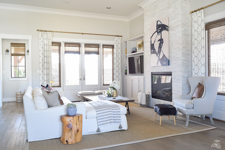 zdesign at home spring tour transitional spring living room fur stool white linen couch hmong pillows boho living room kravet riad drapes SW on the rocks paint-1