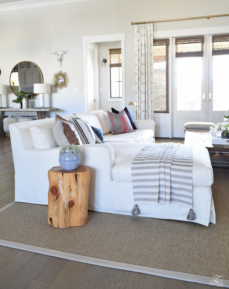 zdesign at home spring living room tour white linen couch hmong pillows leather pillow seagrass rug stump side table bogo tassel throw-6