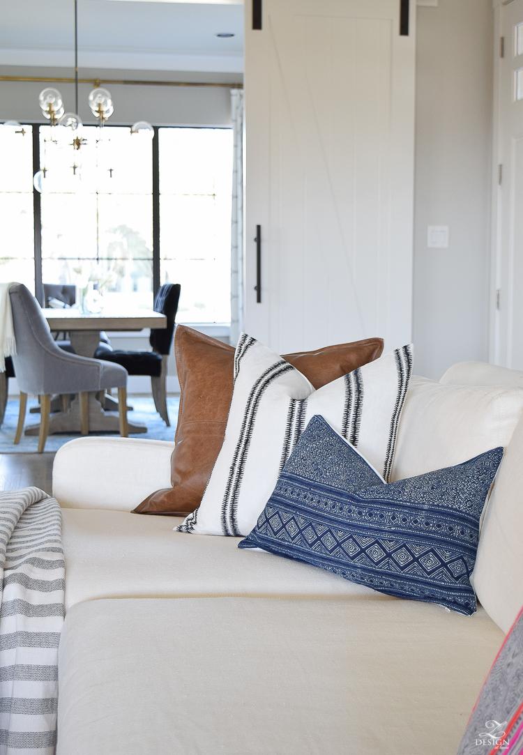 zdesign at home spring tour spark modern pillow leather pillow danielle oakey navy blue pillow artisan hardware barndoors white linen couch-1